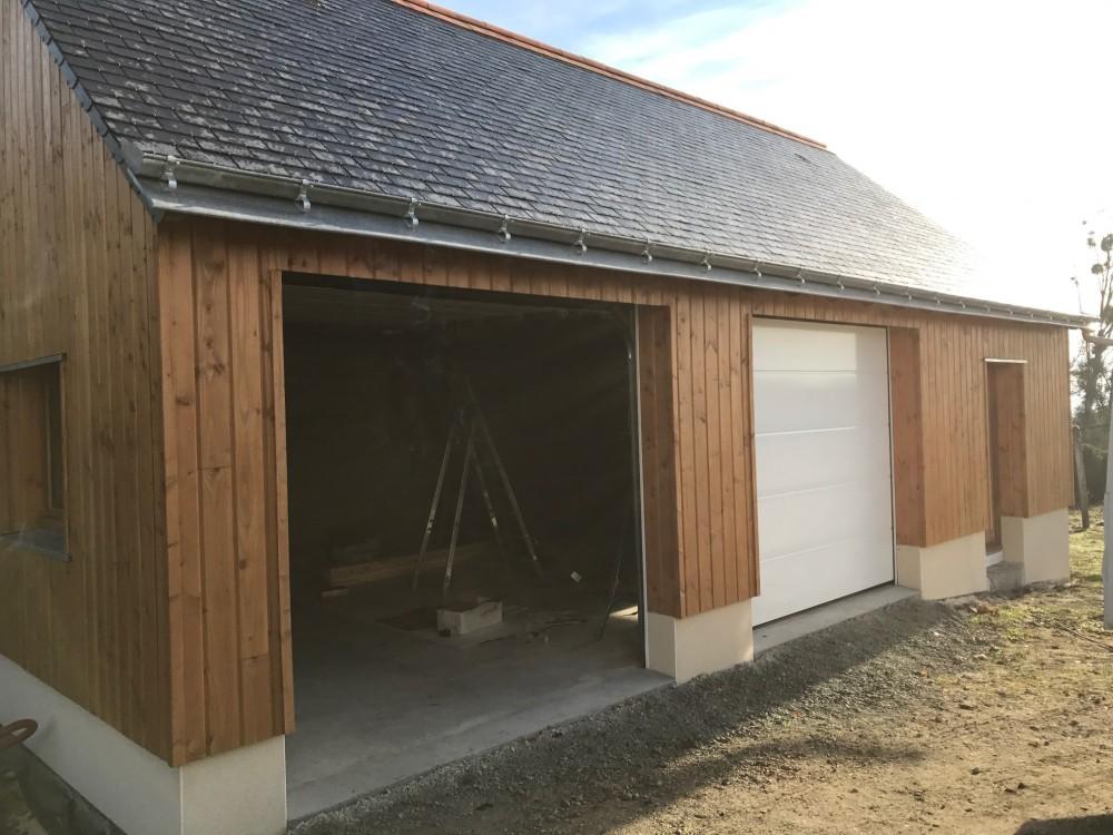 Maison ossature bois toit plat finest maison bois rt with for Extension garage ossature bois